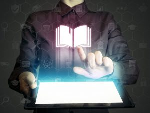 Concept of online learning, person touching a computer to obtain knowledge