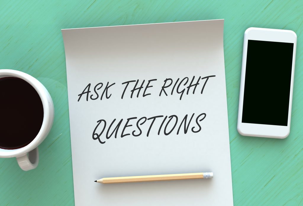 ask the right questions spelled out on a piece of paper www.paladindigitalmarketing.com